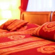 Стоковое фото: Pillows and double bed in interior of modern hotel