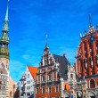 Blackheads house and Saint Peter&#039;s church in Riga - Stock Photo