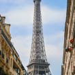Stock Photo: Part of Eiffel Tower on street