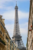 Part of Eiffel Tower on the street — Stock Photo