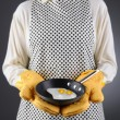Stock Photo: Homemaker Holding Pwith Fried Eggs
