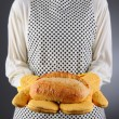 Stock Photo: Homemaker Holding Fresh Loaf of Bread