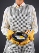 Homemaker Holding Pan with Fried Eggs — Stock Photo