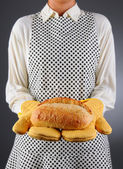 Homemaker Holding Fresh Loaf of Bread — Stock Photo