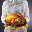 Homemaker Holding Turkey on a Platter — Stockfoto #12193131