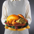 Homemaker Holding Turkey on a Platter — Stock Photo