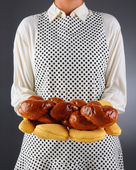 Homemaker Holding a Fresh Baked Loaf of Bread — Stock Photo
