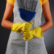 Stock Photo: Housewife Holding Broom