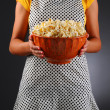 Stock Photo: Homemaker Holding Bowl of Popcorn