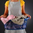 Stock Photo: Housewife with Laundry Basket
