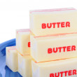 Butter on Blue Plate — Stock Photo