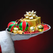 Santa Claus With Gift on Tray — Stock Photo