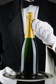 Sommelier Holding Champagne Bottle on Tray — Stock Photo