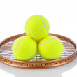 Tennis Balls on Racket — Stockfoto #14939067