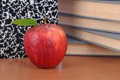 Apple on Teachers Desk — Stock Photo