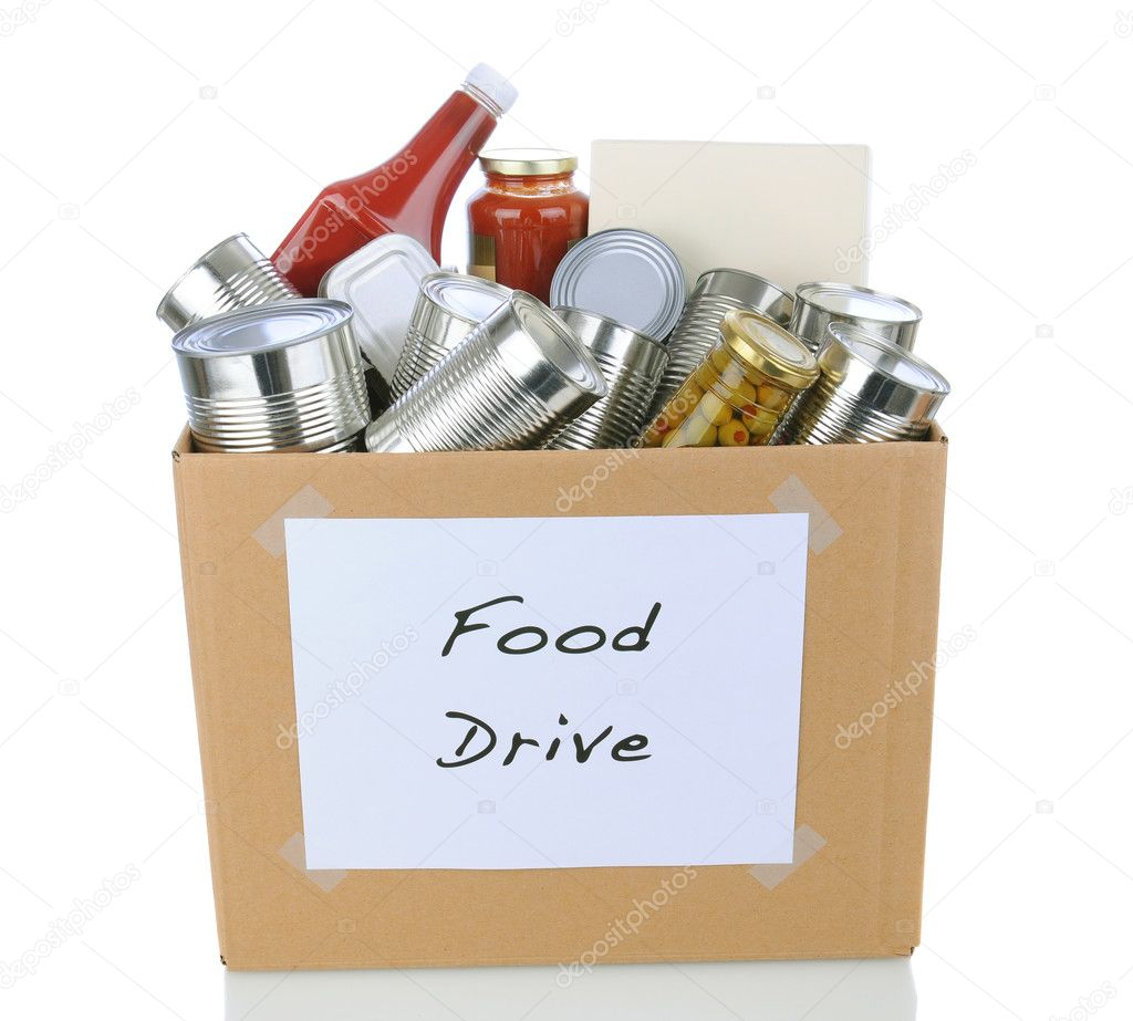 A box full of canned and packaged foodstuff for a charity food donation drive. Isolated on white with reflection. — Stock Photo #14949759