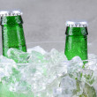 Closeup Beer Bottles in Ice Bucket - Stock Photo
