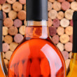 Closeup Wine Bottles in Front of Corks — Stock Photo