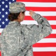 Female Soldier Saluting Flag — Stock Photo #19280409