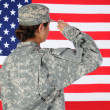 Stock Photo: Female Soldier Saluting Flag