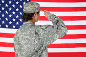 Female Soldier Saluting Flag — Stock Photo