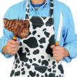 Man in Apron with Steak on Fork — Stock Photo