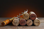 Dated Wine Corks and Corkscrew — Stock Photo