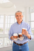 Businessman with Coffee Tray — Stock Photo
