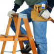 Construction Worker on Ladder - Stock Photo