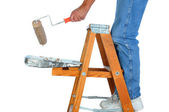 Painter on Ladder with Paint Roller — Stock Photo