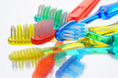 Toothbrushes on Reflective Surface — Stock Photo