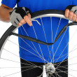 Cyclist Fixing Flat Tire - Stock fotografie