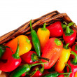 Assorted peppers in basket — Stock Photo