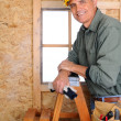 Contractor Leaning on Ladder — Stock Photo