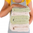 Housewife Holding a Stack of Towels — Stock Photo