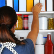 Woman Reaching Into Pantry — Stock Photo