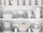 White Plates in Cupboard — Stock Photo