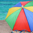 Flip-Flops and Beach Umbrella — 图库照片