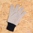 Work Glove on Plywood — Stock Photo