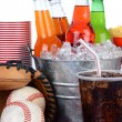 Soda Bucket With Full Glass and Baseball Equipment — Stock Photo