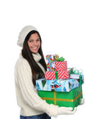 Young Woman Carrying a Stack of Christmas Presents — Photo