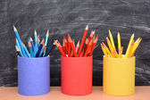 Colored Pencils in Matching Pencil Cups — Stock Photo