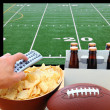 Hand with TV Remote, Beer, Chips and football — Stock Photo