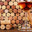 Glass of Wine  in Front of a Wall of Used Corks — Stock Photo