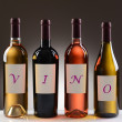 Wine Bottles With Labels Spelling Out Vino — Stock Photo