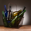 A Wire Shopping Basket Filled With Empty Bottles — Stock Photo #34620221
