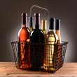 A Wire Shopping Basket Filled With Wine Bottles — Stock Photo #34620269