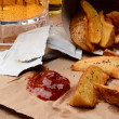 French Fries With Ketchup on Brown Bag And Beer — Stock Photo