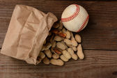 Baseball and a Bag With Peanuts Spilling Out — Stock Photo