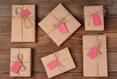 Six Holiday Packages on Wood Surface — Stock Photo